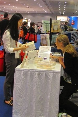 Stephanie Dale, signing books at Book Expo America, 2012
