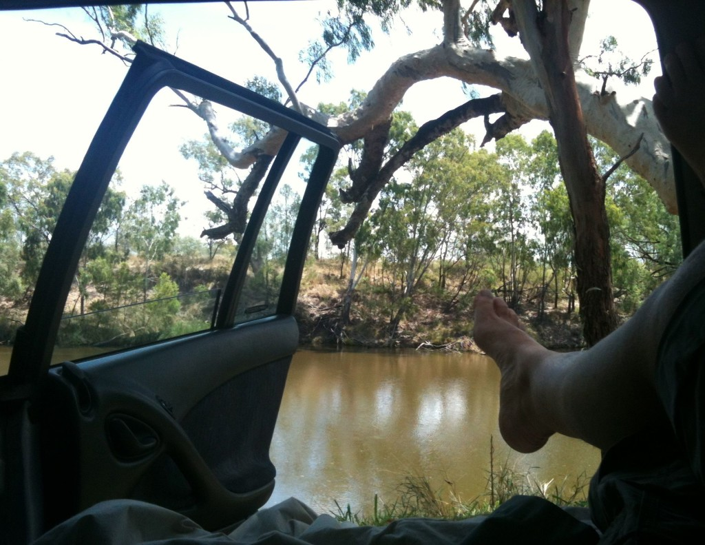 The loser in her lounge room, by the banks of an outback river.